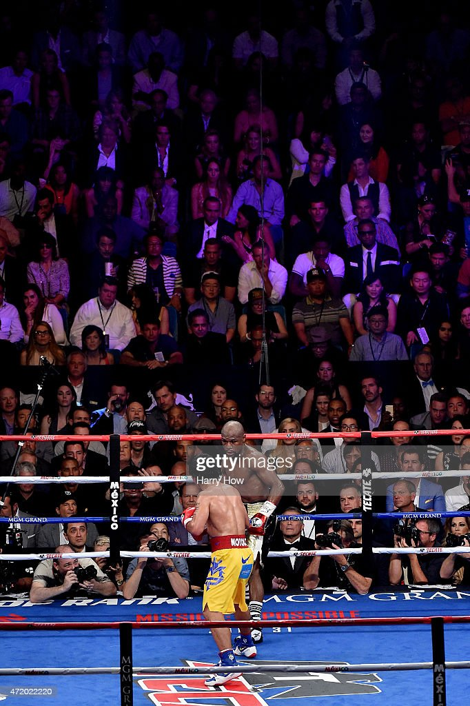 Floyd Mayweather Jr and Manny Pacquiao in the ring during their welterweight unification championship bout on May 2 2015 at MGM Grand Garden Arena in...