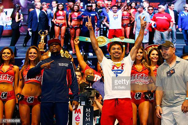 Floyd Mayweather Jr and Manny Pacquiao pose during their official weighin on May 1 2015 at MGM Grand Garden Arena in Las Vegas Nevada The two will...