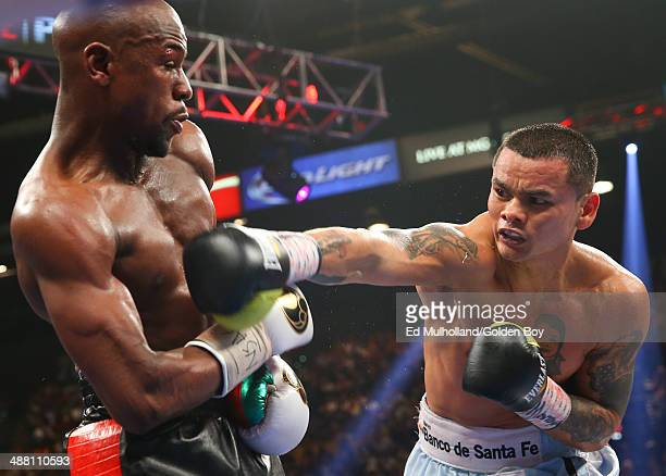 Floyd Mayweather Jr and Marcos Maidana during their WBA/WBC welterweight unification fight at the MGM Grand Garden Arena on May 3 2014 in Las Vegas...