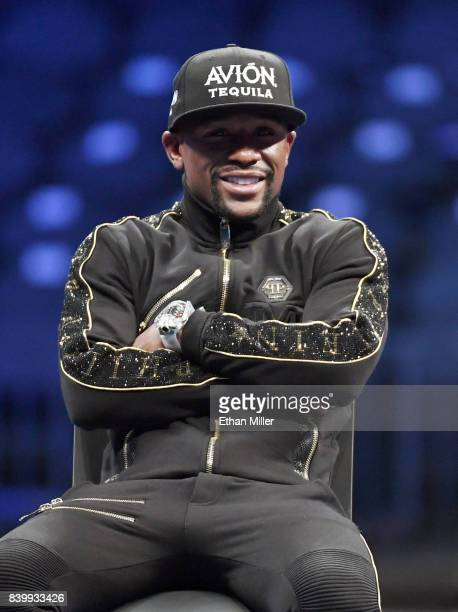 Floyd Mayweather Jr attends a news conference after defeating Conor McGregor by 10thround TKO in their super welterweight boxing match at TMobile...