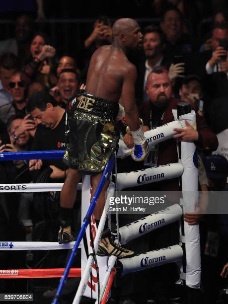 Floyd Mayweather Jr celebrates after his TKO of Conor McGregor in their super welterweight boxing match on August 26 2017 at TMobile Arena in Las...