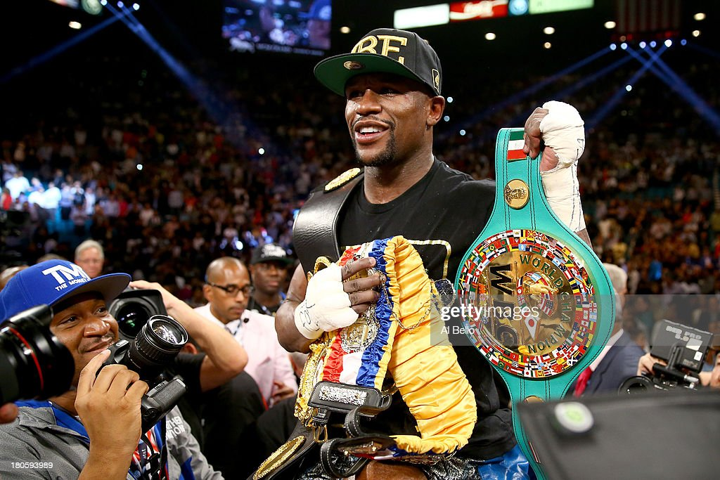 Floyd Mayweather Jr. celebrates his majority decision victory against Canelo Alvarez in their WBC/WBA 154-pound title fight at the MGM Grand Garden Arena on September 14, 2013 in Las Vegas, Nevada.