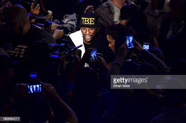 Floyd Mayweather Jr celebrates his majority decision victory against Canelo Alvarez in their WBC/WBA 154pound title fight at the MGM Grand Garden...