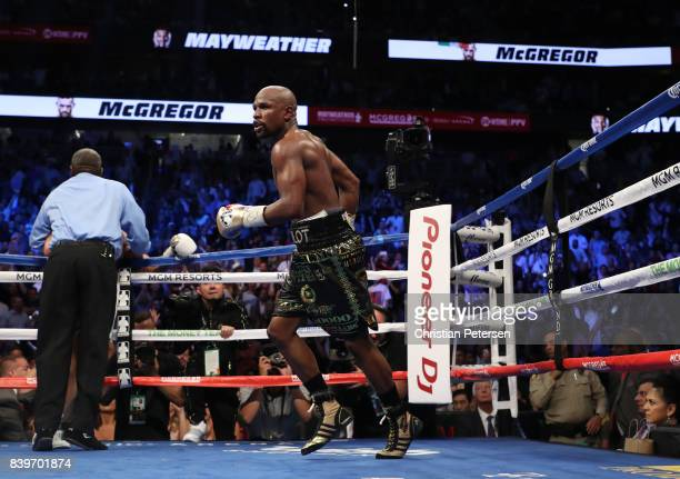 Floyd Mayweather Jr celebrates his TKO of Conor McGregor in their super welterweight boxing match on August 26 2017 at TMobile Arena in Las Vegas...