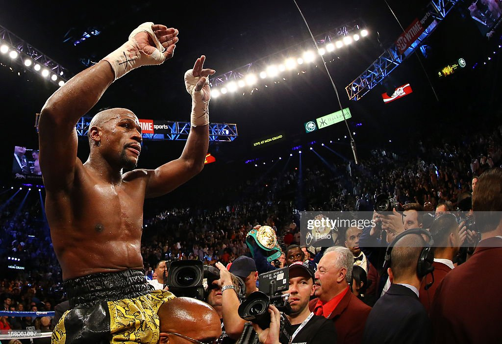 <a gi-track='captionPersonalityLinkClicked' href=/galleries/search?phrase=Floyd+Mayweather+Jr&family=editorial&specificpeople=2294114 ng-click='$event.stopPropagation()'>Floyd Mayweather Jr</a>. celebrates his unanimous-decision victory over Robert Guerrero in their WBC welterweight title bout at the MGM Grand Garden Arena on May 4, 2013 in Las Vegas, Nevada.