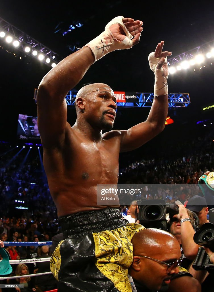 <a gi-track='captionPersonalityLinkClicked' href=/galleries/search?phrase=Floyd+Mayweather+Jr.&family=editorial&specificpeople=2294114 ng-click='$event.stopPropagation()'>Floyd Mayweather Jr.</a> celebrates his unanimous-decision victory over Robert Guerrero in their WBC welterweight title bout at the MGM Grand Garden Arena on May 4, 2013 in Las Vegas, Nevada.