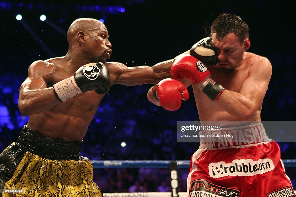 <a gi-track='captionPersonalityLinkClicked' href=/galleries/search?phrase=Floyd+Mayweather+Jr.&family=editorial&specificpeople=2294114 ng-click='$event.stopPropagation()'>Floyd Mayweather Jr.</a> connects with a left to the face of <a gi-track='captionPersonalityLinkClicked' href=/galleries/search?phrase=Robert+Guerrero&family=editorial&specificpeople=2738116 ng-click='$event.stopPropagation()'>Robert Guerrero</a> in their WBC welterweight title bout at the MGM Grand Garden Arena on May 4, 2013 in Las Vegas, Nevada.