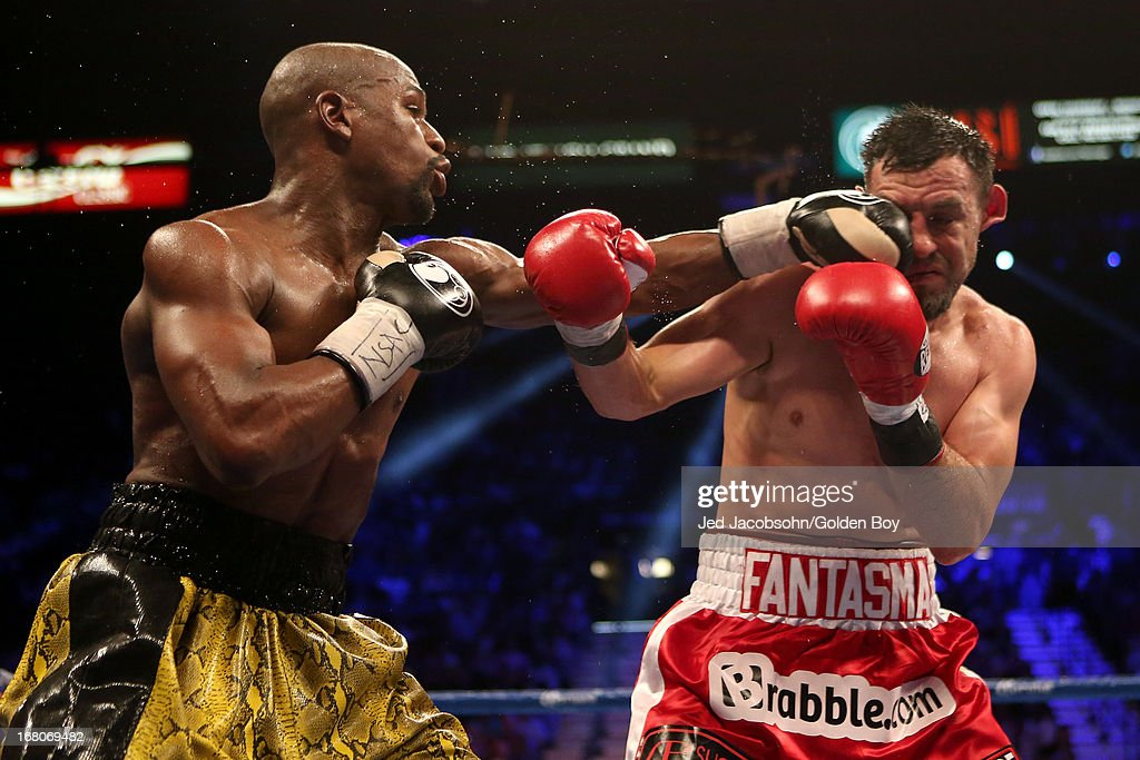 Floyd Mayweather Jr. connects with a left to the face of Robert Guerrero in their WBC welterweight title bout at the MGM Grand Garden Arena on May 4, 2013 in Las Vegas, Nevada.