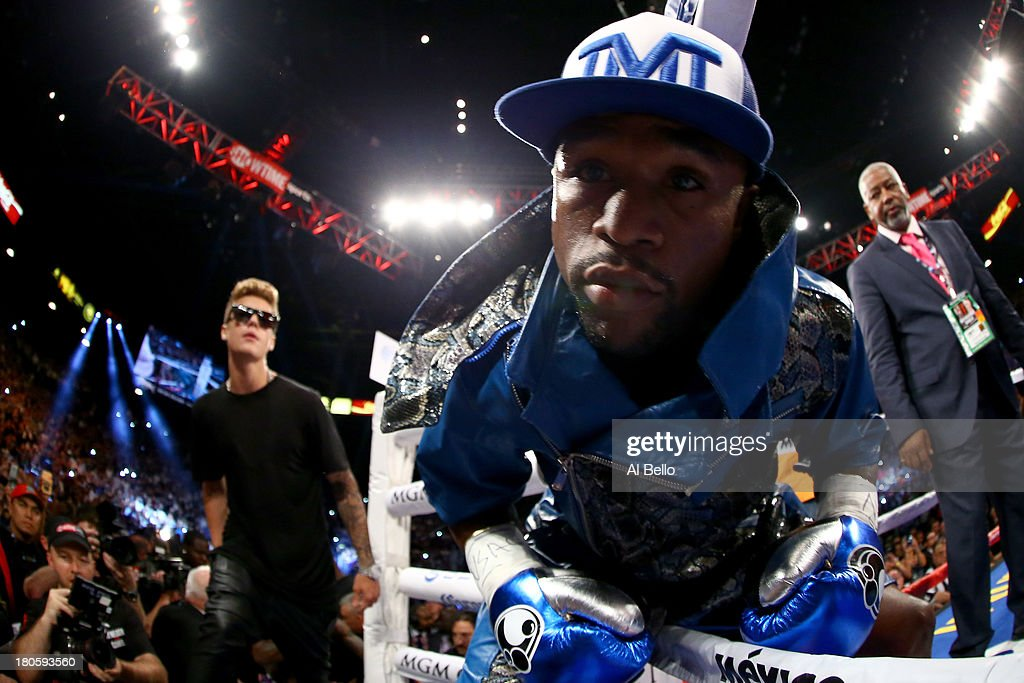 Floyd Mayweather Jr. enters the ring alongside singer <a gi-track='captionPersonalityLinkClicked' href=/galleries/search?phrase=Justin+Bieber&family=editorial&specificpeople=5780923 ng-click='$event.stopPropagation()'>Justin Bieber</a> (L) to take on Canelo Alvarez in their WBC/WBA 154-pound title fight at the MGM Grand Garden Arena on September 14, 2013 in Las Vegas, Nevada.