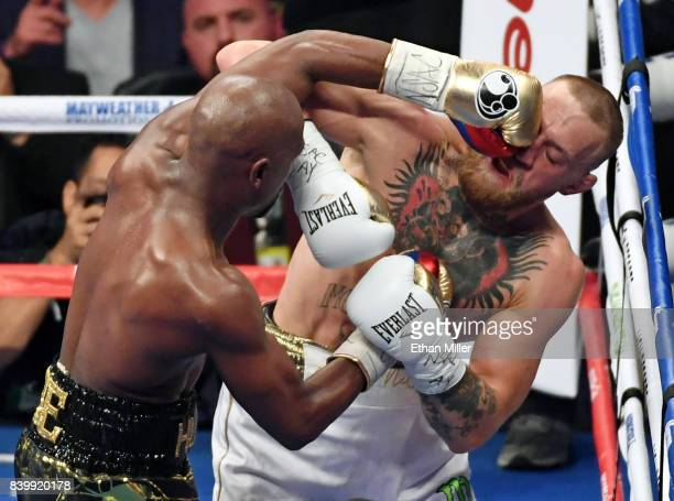 Floyd Mayweather Jr hits Conor McGregor in the sixth round of their super welterweight boxing match at TMobile Arena on August 26 2017 in Las Vegas...