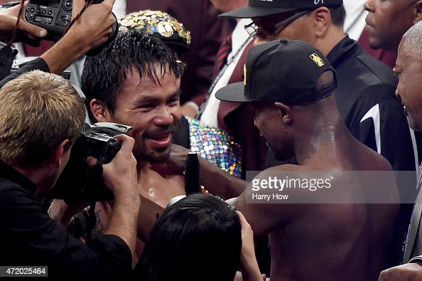 Floyd Mayweather Jr hug Manny Pacquiao after the welterweight unification championship bout on May 2 2015 at MGM Grand Garden Arena in Las Vegas...