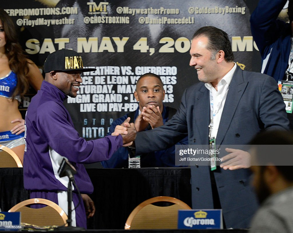 Floyd Mayweather Jr. (L) is greeted on stage by CEO of Golden Boy Promotions Richard Schaefer during the news conference after the Floyd Mayweather Jr. and Robert Guerrero fight at the MGM Grand Garden Arena on May 4, 2013 in Las Vegas, Nevada. Floyd Mayweather Jr. defeated Robert Guerrero to maintain his WBC welterweight title.
