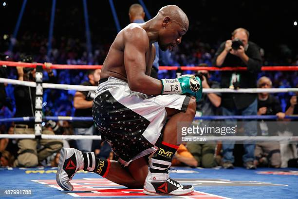 Floyd Mayweather Jr kneels on the mat after winning his WBC/WBA welterweight title fight against Andre Berto at MGM Grand Garden Arena on September...