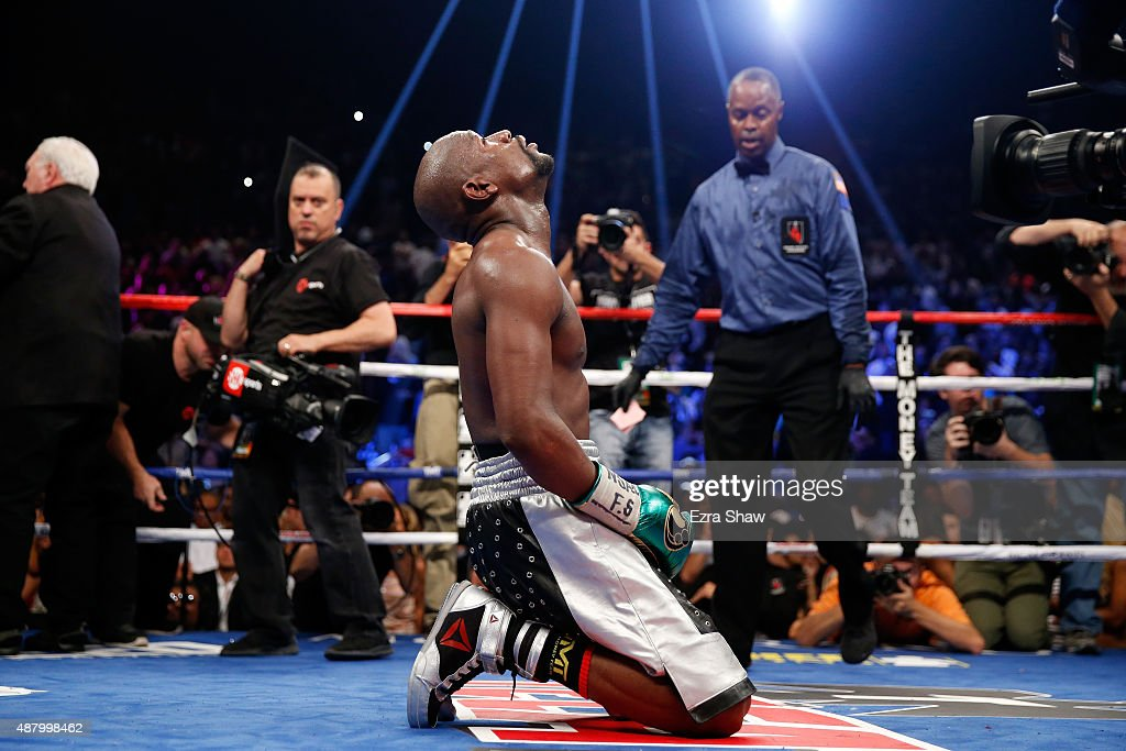 <a gi-track='captionPersonalityLinkClicked' href=/galleries/search?phrase=Floyd+Mayweather+Jr.&family=editorial&specificpeople=2294114 ng-click='$event.stopPropagation()'>Floyd Mayweather Jr.</a> kneels on the mat after winning his WBC/WBA welterweight title fight against Andre Berto at MGM Grand Garden Arena on September 12, 2015 in Las Vegas, Nevada. Mayweather won the fight by unanimous decision.