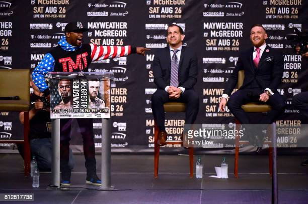 Floyd Mayweather Jr laughs at Conor McGregor during the Floyd Mayweather Jr v Conor McGregor World Press Tour at Staples Center on July 11 2017 in...