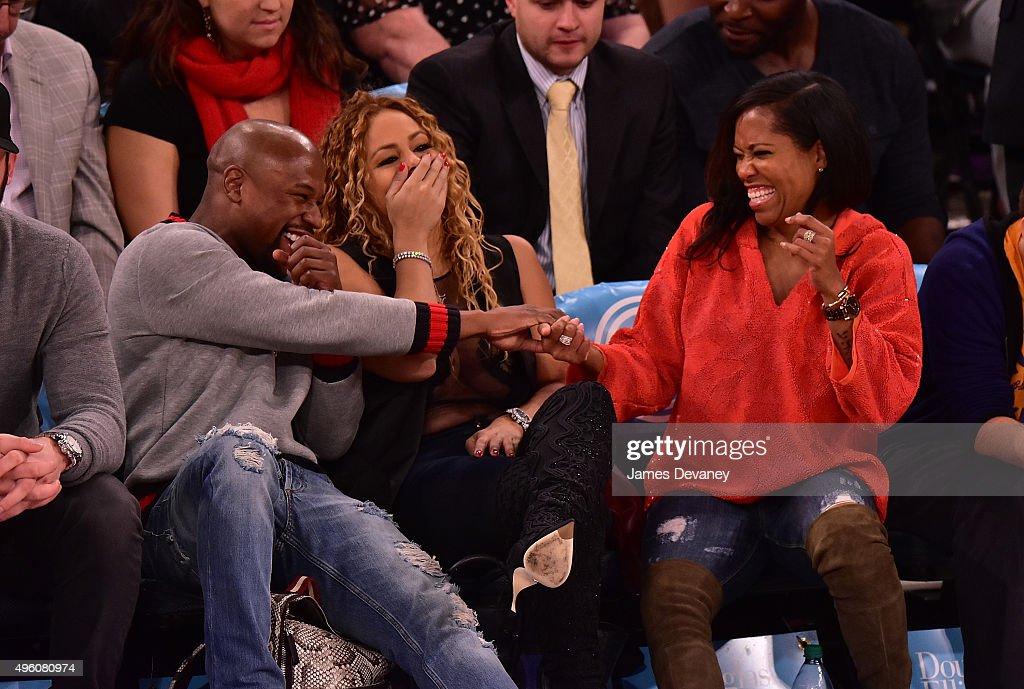 Floyd Mayweather Jr., Liza Hernandez and Regina King attend New York Knicks vs Milwaukee Bucks game at Madison Square Garden on November 6, 2015 in New York City.