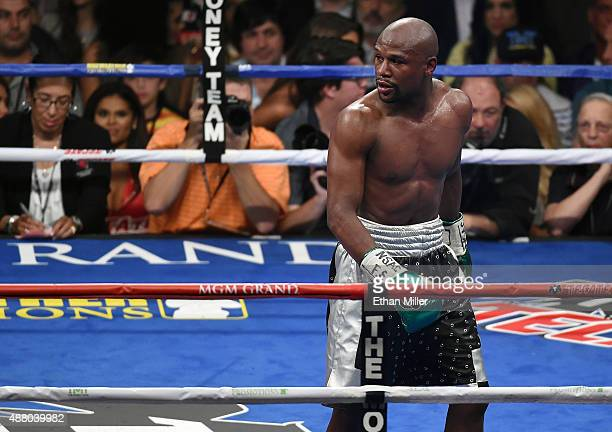 Floyd Mayweather Jr looks back at Andre Berto's corner after the sixth round of their WBC/WBA welterweight title fight at MGM Grand Garden Arena on...