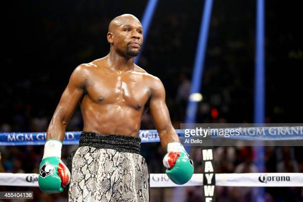 Floyd Mayweather Jr looks on while taking on Marcos Maidana during their WBC/WBA welterweight title fight at the MGM Grand Garden Arena on September...