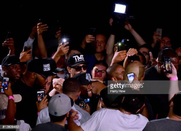 Floyd Mayweather Jr makes his way to the stage for the Floyd Mayweather Jr v Conor McGregor World Press Tour at Staples Center on July 11 2017 in Los...