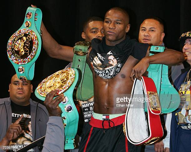 Floyd Mayweather Jr of Nevada poses with his belts during his official weighin at the Mandalay Bay Events Center November 3 2006 in Las Vegas Nevada...
