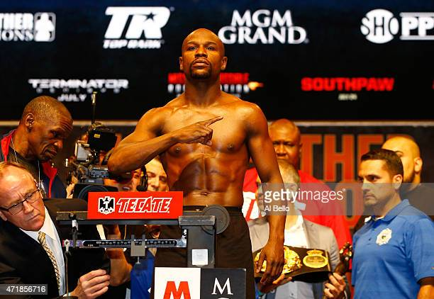 Floyd Mayweather Jr poses on the scale during his official weighin on May 1 2015 at MGM Grand Garden Arena in Las Vegas Nevada Mayweather will face...