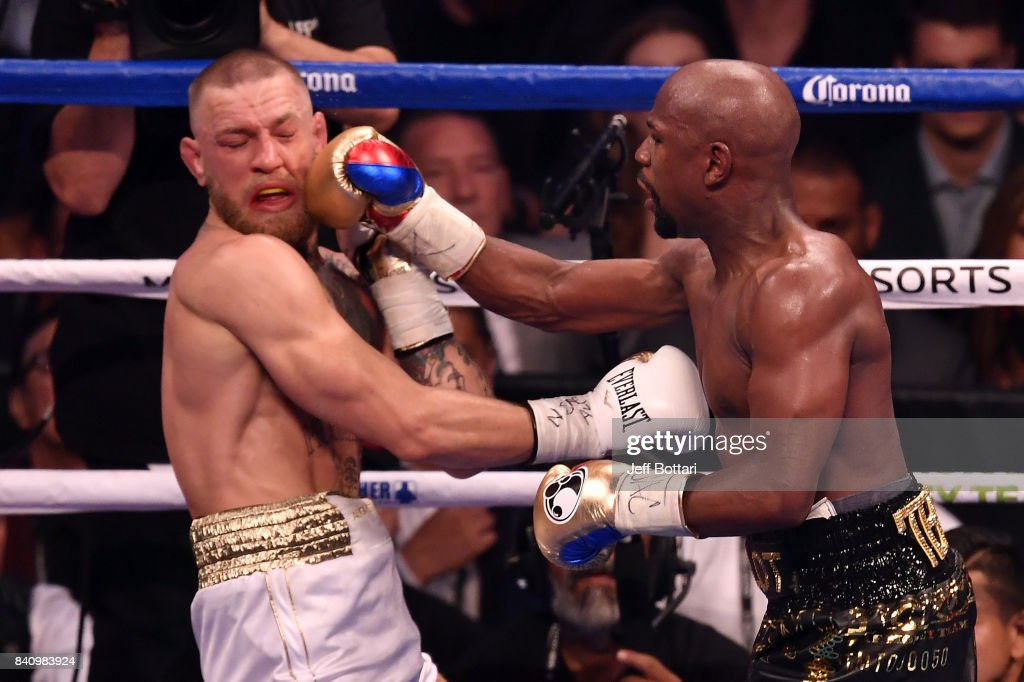 Floyd Mayweather Jr. punches Conor McGregor in their super welterweight boxing match at T-Mobile Arena on August 26, 2017 in Las Vegas, Nevada. Mayweather won by 10th-round TKO.