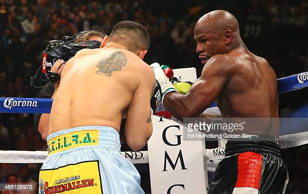 Floyd Mayweather Jr punches Marcos Maidana during their WBA/WBC welterweight unification fight at the MGM Grand Garden Arena on May 3 2014 in Las...