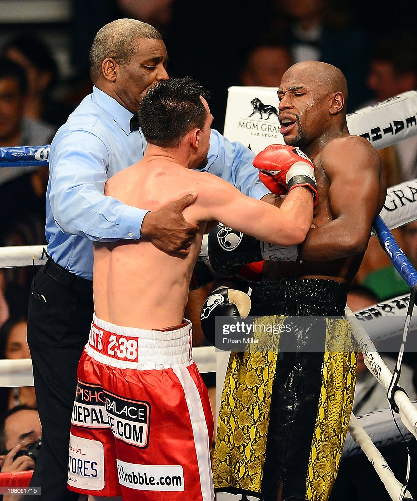 Floyd Mayweather Jr. reacts as Robert Guerrero attempts to throw a punch as referee Robert Byrd holds Guerrero back in their WBC welterweight title bout at the MGM Grand Garden Arena on May 4, 2013 in Las Vegas, Nevada.