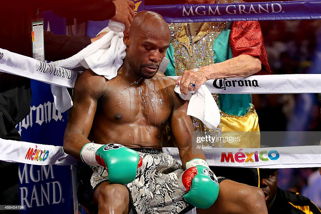 Floyd Mayweather Jr sits in corner during a break between rounds while taking on Marcos Maidana during their WBC/WBA welterweight title fight at the...