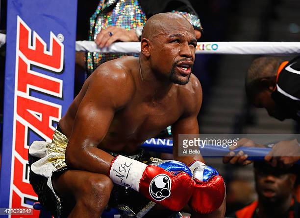 Floyd Mayweather Jr sits in his corner between rounds against Manny Pacquiao during their welterweight unification championship bout on May 2 2015 at...