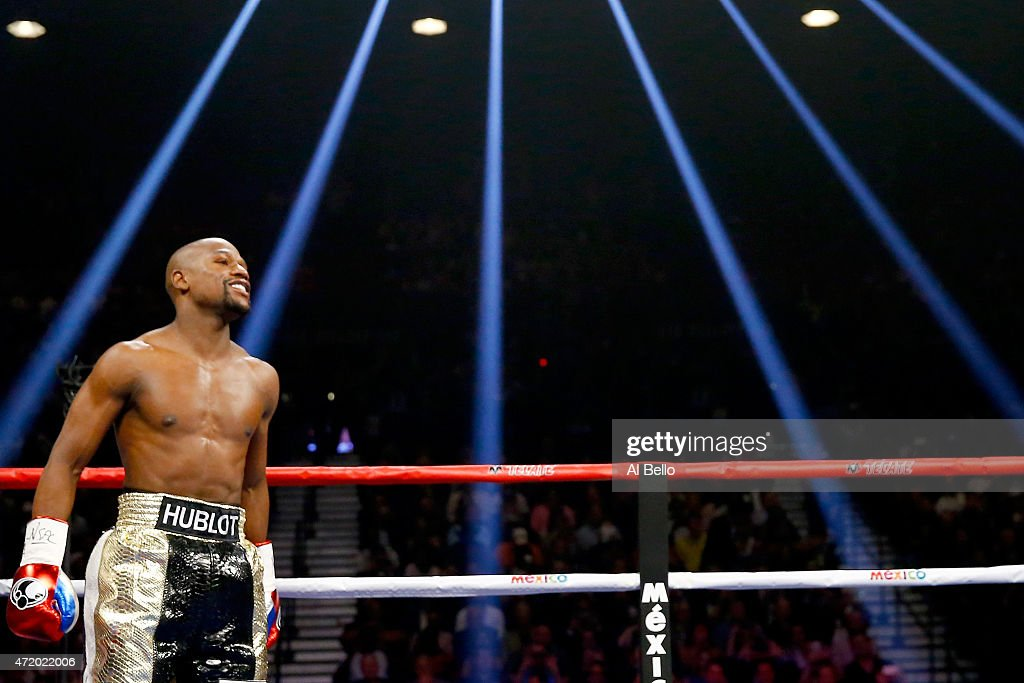 <a gi-track='captionPersonalityLinkClicked' href=/galleries/search?phrase=Floyd+Mayweather+Jr.&family=editorial&specificpeople=2294114 ng-click='$event.stopPropagation()'>Floyd Mayweather Jr.</a> smiles during the welterweight unification championship bout on May 2, 2015 at MGM Grand Garden Arena in Las Vegas, Nevada.