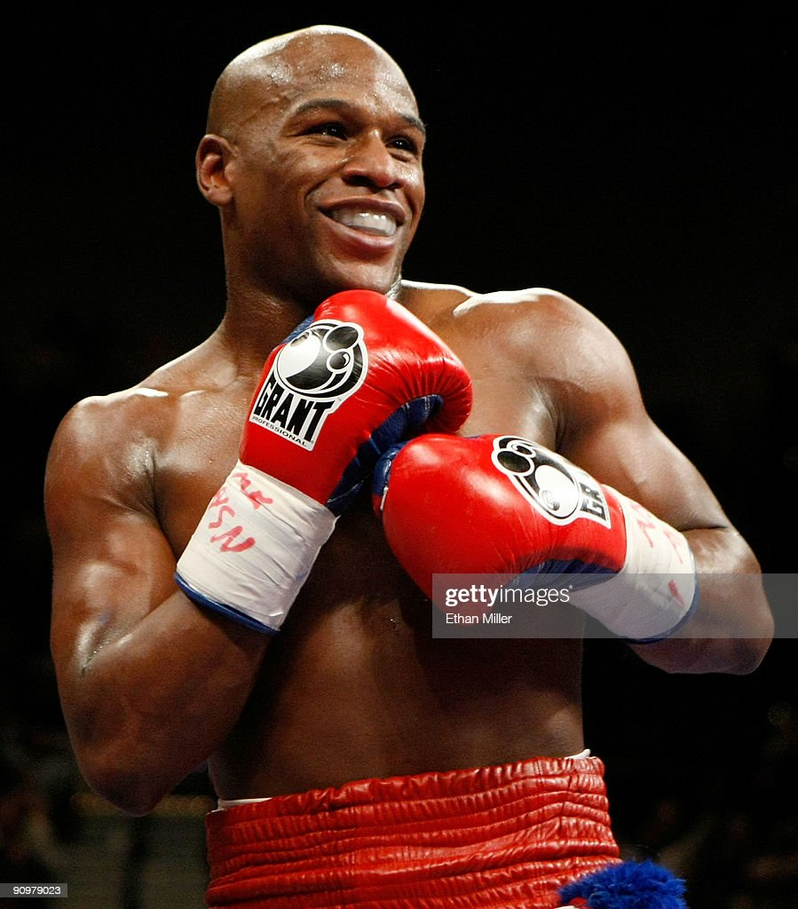 <a gi-track='captionPersonalityLinkClicked' href=/galleries/search?phrase=Floyd+Mayweather+Jr.&family=editorial&specificpeople=2294114 ng-click='$event.stopPropagation()'>Floyd Mayweather Jr.</a> smiles in the ring during his fight against Juan Manuel Marquez at the MGM Grand Garden Arena September 19, 2009 in Las Vegas, Nevada. Mayweather won by unanimous decision.