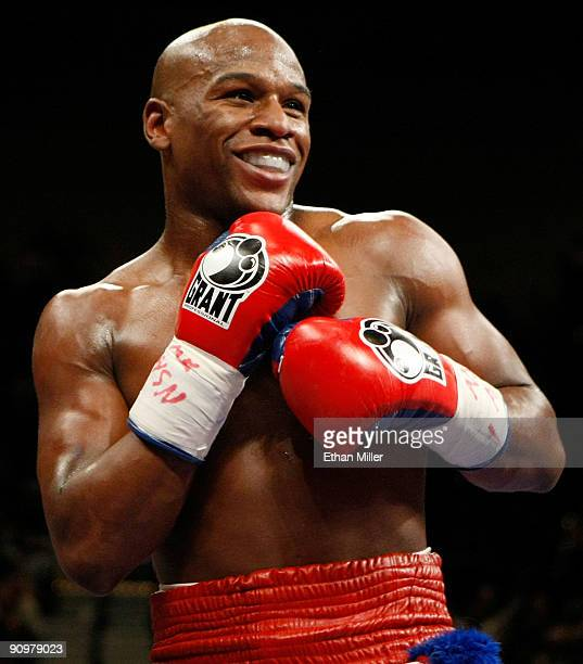 Floyd Mayweather Jr smiles in the ring during his fight against Juan Manuel Marquez at the MGM Grand Garden Arena September 19 2009 in Las Vegas...