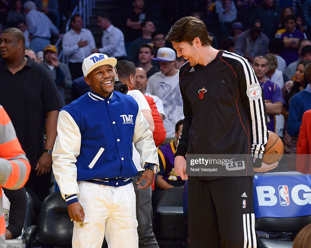 Floyd Mayweather Jr (L) speaks with Mike Miller attend a basketball game between the Miami Heat and the Los Angeles Lakers at Staples Center on January 17, 2013 in Los Angeles, California.