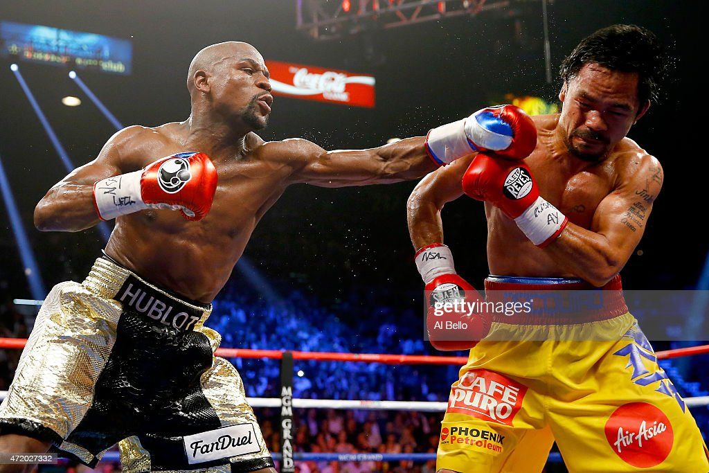 <a gi-track='captionPersonalityLinkClicked' href=/galleries/search?phrase=Floyd+Mayweather+Jr.&family=editorial&specificpeople=2294114 ng-click='$event.stopPropagation()'>Floyd Mayweather Jr.</a> throws a left at <a gi-track='captionPersonalityLinkClicked' href=/galleries/search?phrase=Manny+Pacquiao&family=editorial&specificpeople=3855506 ng-click='$event.stopPropagation()'>Manny Pacquiao</a> during their welterweight unification championship bout on May 2, 2015 at MGM Grand Garden Arena in Las Vegas, Nevada.