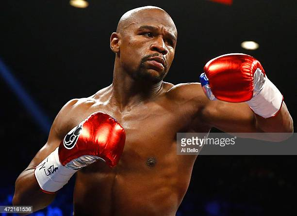Floyd Mayweather Jr throws a left at Manny Pacquiao during their welterweight unification championship bout on May 2 2015 at MGM Grand Garden Arena...