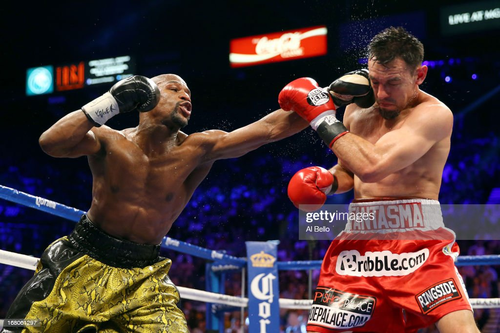 <a gi-track='captionPersonalityLinkClicked' href=/galleries/search?phrase=Floyd+Mayweather+Jr&family=editorial&specificpeople=2294114 ng-click='$event.stopPropagation()'>Floyd Mayweather Jr</a>. throws a left to the face of <a gi-track='captionPersonalityLinkClicked' href=/galleries/search?phrase=Robert+Guerrero&family=editorial&specificpeople=2738116 ng-click='$event.stopPropagation()'>Robert Guerrero</a> in their WBC welterweight title bout at the MGM Grand Garden Arena on May 4, 2013 in Las Vegas, Nevada.