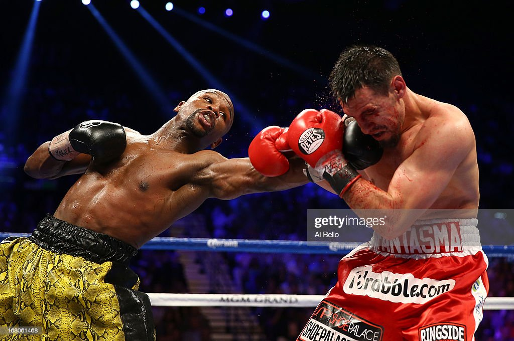 <a gi-track='captionPersonalityLinkClicked' href=/galleries/search?phrase=Floyd+Mayweather+Jr.&family=editorial&specificpeople=2294114 ng-click='$event.stopPropagation()'>Floyd Mayweather Jr.</a> throws a left to the face of <a gi-track='captionPersonalityLinkClicked' href=/galleries/search?phrase=Robert+Guerrero&family=editorial&specificpeople=2738116 ng-click='$event.stopPropagation()'>Robert Guerrero</a> in their WBC welterweight title bout at the MGM Grand Garden Arena on May 4, 2013 in Las Vegas, Nevada.