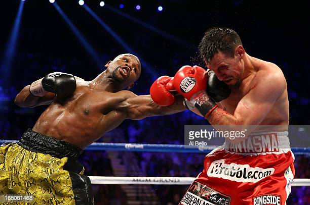 Floyd Mayweather Jr throws a left to the face of Robert Guerrero in their WBC welterweight title bout at the MGM Grand Garden Arena on May 4 2013 in...