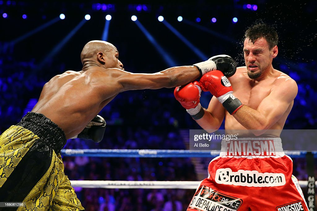 Floyd Mayweather Jr. throws a right to the face of Robert Guerrero in their WBC welterweight title bout at the MGM Grand Garden Arena on May 4, 2013 in Las Vegas, Nevada.