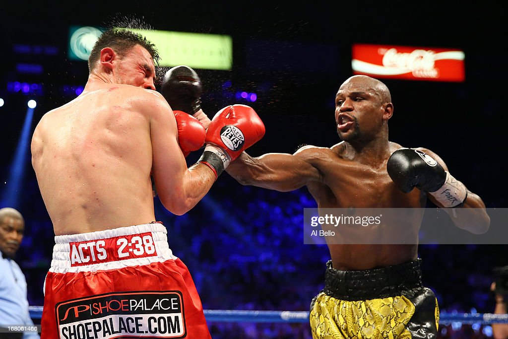 <a gi-track='captionPersonalityLinkClicked' href=/galleries/search?phrase=Floyd+Mayweather+Jr&family=editorial&specificpeople=2294114 ng-click='$event.stopPropagation()'>Floyd Mayweather Jr</a>. throws a right to the face of <a gi-track='captionPersonalityLinkClicked' href=/galleries/search?phrase=Robert+Guerrero&family=editorial&specificpeople=2738116 ng-click='$event.stopPropagation()'>Robert Guerrero</a> in their WBC welterweight title bout at the MGM Grand Garden Arena on May 4, 2013 in Las Vegas, Nevada.