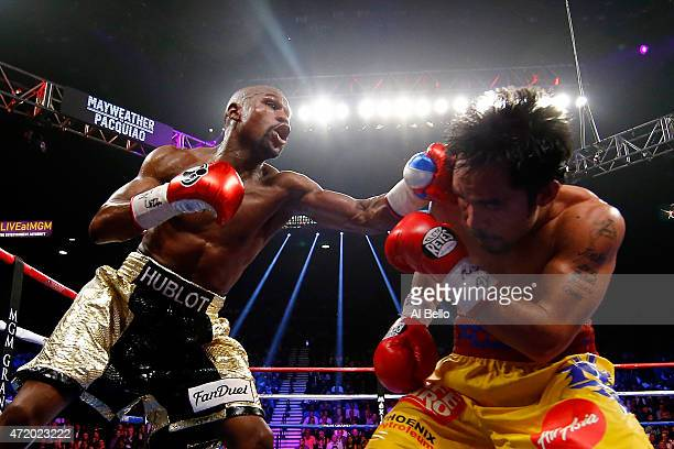 Floyd Mayweather Jr throws left at Manny Pacquiao during their welterweight unification championship bout on May 2 2015 at MGM Grand Garden Arena in...