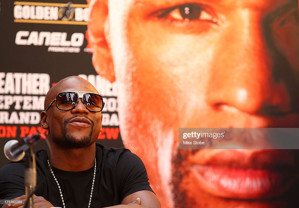 Floyd Mayweather looks on during a news conference at the Pedestrian Walk in Times Square on June 24, 2013 in New York City. Floyd Mayweather and Canelo Alvarez are scheduled to fight September 14 at the MGM Grand in Las Vegas, Nevada to unifty their junior middleweight world titles.