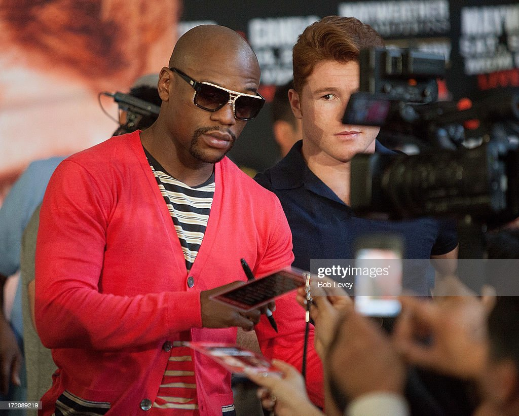 Floyd Mayweather signs autographs after a press conference July 1, 2013 at Union Station at Minute Maid Park in Houston, Texas. Floyd Mayweather and Canelo Alvarez are scheduled to fight September 14 at the MGM Grand Garden Arena in Las Vegas, Nevada.