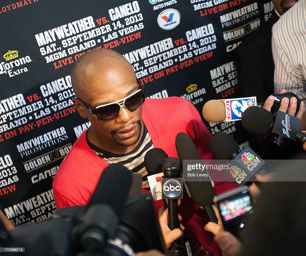 Floyd Mayweather talks with the media after a press conference discussing his upcoming championship fight with Canelo Alvarez July 1, 2013 at Union Station at Minute Maid Park in Houston, Texas. Floyd Mayweather and Canelo Alvarez are scheduled to fight September 14 at the MGM Grand Garden Arena in Las Vegas, Nevada.