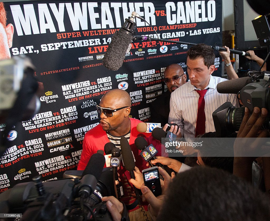 Floyd Mayweather talks with the media after press conference discussing his upcoming championship fight with Canelo Alvarez July 1, 2013 at Union Station at Minute Maid Park in Houston, Texas. Floyd Mayweather and Canelo Alvarez are scheduled to fight September 14 at the MGM Grand Garden Arena in Las Vegas, Nevada.