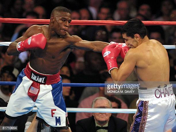 Floyd Mayweather WBC Champion lands a punch on WBC contender Jesus Chavez during their bout 10 November 2001 in San Francisco CA Mayweather Jr posted...