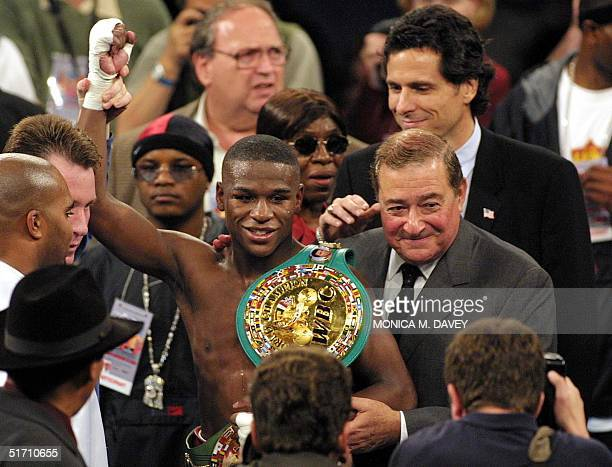 Floyd Mayweather WBC Champion stands with promoter Bob Arun 10 November 2001 in San Francisco CA after defeating contender Jesus Chavez of Mexico...