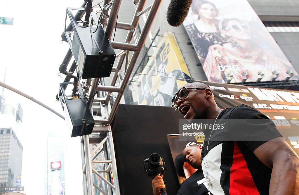 Floyd Mayweather yells out to the crowd during a news conference at the Pedestrian Walk in Times Square on June 24, 2013 in New York City. Floyd Mayweather and Canelo Alvarez are scheduled to fight September 14 at the MGM Grand in Las Vegas, Nevada to unifty their junior middleweight world titles.