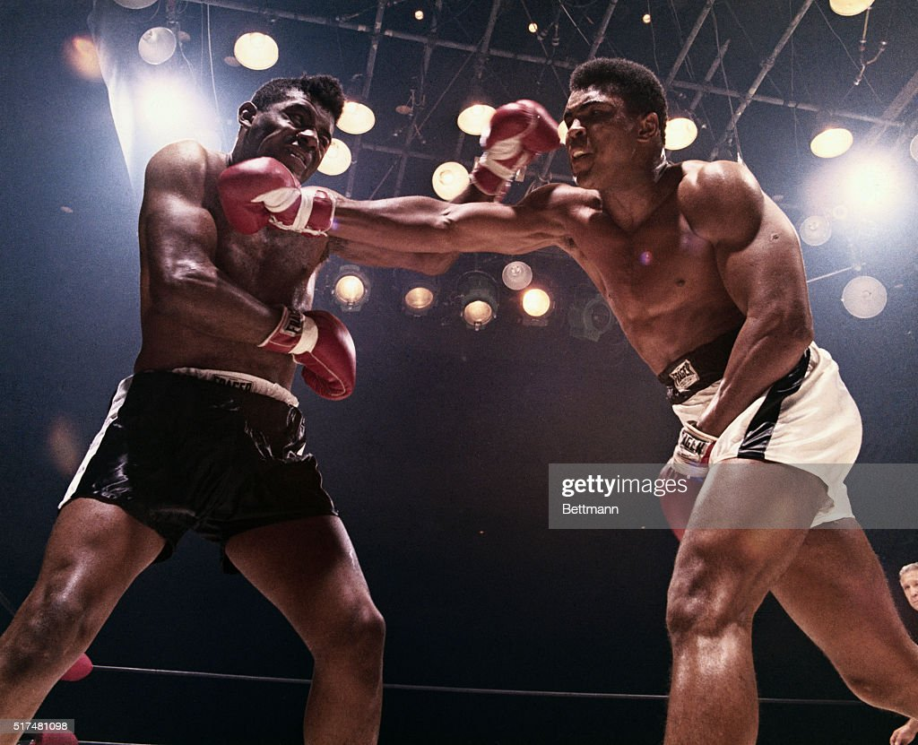 Floyd Patterson and Muhammad Ali (aka Cassius Clay) each land a blow on the other. Ali won and retained his title of heavyweight champion.